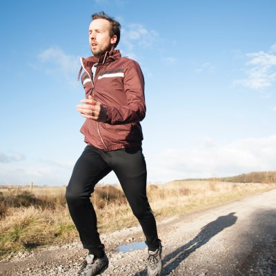 Photo of man running to illustrate health benefit of exercise
