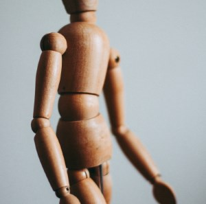 wooden doll illustrates value of chiropractic manipulation