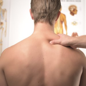 picture of man with shoulders being massaged