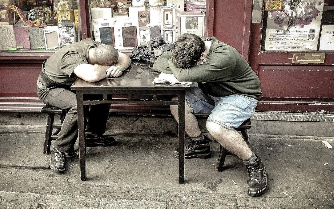 picture of two tired men for chiropractic and adrenal fatigue article