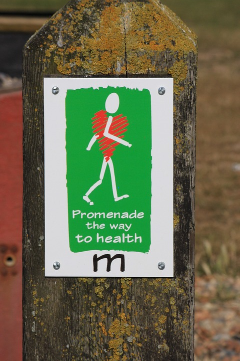 picture of a sign where a stick figure is walking to show heart health